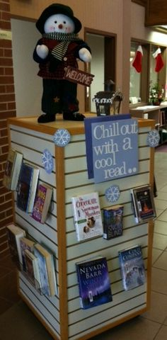"""Brrr... it's cold outside today!! If you need a good book to read, stop by here first before you settle in! :) Our """"Chill out with a cool read.."""" display offers titles such as: """"A Winter Dream"""" by Richard Paul Evans, """"The Chocolate Snowman Murders"""" by Joanna Carl"""", """"Winter Study"""" by Nevada Barr, and """"Snow Blind"""" by P.J. Tracy. — at Central City Public Library (Central City, Nebraska)"""