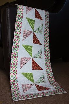 After a lot of searching I think this is my piano table runner for Christmas season.  Now to get sewing it.
