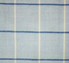 Falkirk Fabric A box check fabric with thin denim and white stripes on a powder blue background.