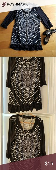 Black and white mini dress Style & Co., black and white mini dress or could be work as a tunic with leggings or jeans.atching ruffle on bottom and end of 3/4 length sleeve. Not form fitting, more of a shift dress fit. 92% polyester, 8% spandex. Love the pattern, slightest bit of pilling around center design, not noticeable at all. Style & Co Dresses Mini