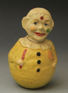 clown suit | Clown in yellow suit roly poly - ca 1920s. Missing hat. $50