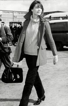 Françoise Hardy in a striped sweater, coat, and loafers