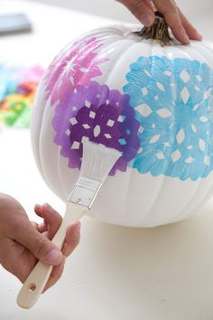 Decoupage pumpkins: Cut snowflake-light designs from different colored tissue paper. Brush Mod Podge onto your pumpkin and place your designs on top. Once in place,lightly brush another layer of Mod Podge over the tissue paper.