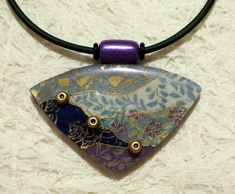 Elsie Smith - Washi Paper over Polymer Clay  Asian style pendants sealed with glassy Kato liquid.