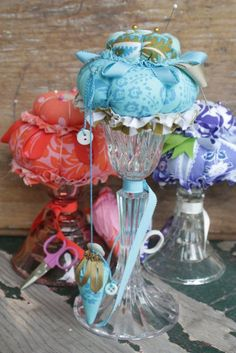 First candlestick pin keeps that I like with stacked cushions, the dangling buttons and emery strawberry are sweet ....