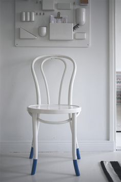 The blue feet on this painted chair is a great way to add a unique detail to a typical painted solution.