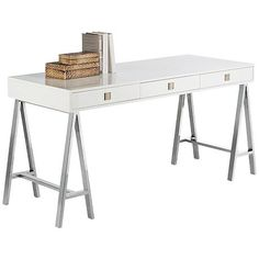 In a high-gloss white finish with stainless steel legs, this contemporary desk offers high designer style.