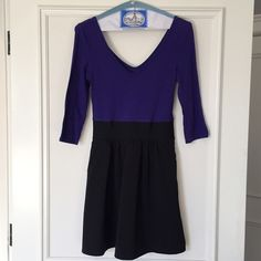 Express dress This is great for the winter. You can pair with tights & a cropped leather jacket. It cinches at the waist & have a v in the front & back. It also has pockets. Express Dresses