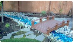 landscaping with recycled windshield glass. Would look really cool in the corner of the fenced yard. - All For Garden Stone Landscaping, Landscaping With Rocks, Outdoor Landscaping, Front Yard Landscaping, Windshield Glass, Garden Landscape Design, Landscape Glass, Fenced In Yard, Lawn And Garden