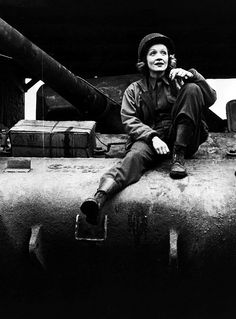 Dietrich toured the European front for the USO, 1944-45. Seen here on a Sherman tank wearing double buckle boots!