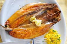 Kippers - There are roughly 125 calories in an average sized smoked kipper fillet, so this will make a quick and satisfying breakfast. http://www.amazon.co.uk/dp/B00DNJCCG0