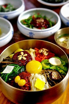Bibimbap(비빕밥) - steamed rice, sautéed mix of vegetables, meat, sunny side up egg, mix with Korean chili paste. Serve in metal bowl or hot stone bowl! So good! Healthy! And fun/easy to make...