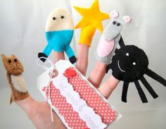 I like this set of felt finger puppets to be used with nursery rhyme songs . . . kids would enjoy putting the puppets on and singing with you or on their own.  Handmade by Amii Spark, of Fait Avec le Coeur -- http://www.etsy.com/listing/119002082/nursery-rhyme-finger-puppets-song-bag