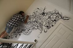 """Me finishing off the Psychedelic """"kiss"""" Mural work on the bit of wall above a client's staircase...    Martin Butler- ELIXIRSUE.CO.UK"""