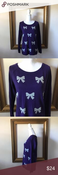Ann Taylor LOFT purple grey bow print sweater In good used condition. 19 inches armpit to armpit. 25 inches shoulder to bottom of sweater. LOFT Sweaters Crew & Scoop Necks