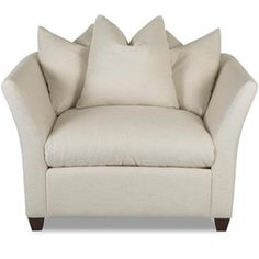 Add a touch of timeless elegance to your living room or den decor with this lovely wood-framed arm chair, showcasing a pillow-back design and exposed wood le...