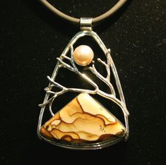 Rare Biggs Picture Jasper from Oregon, with a pearl, set in sterling silver by Artist Michael Kenney.