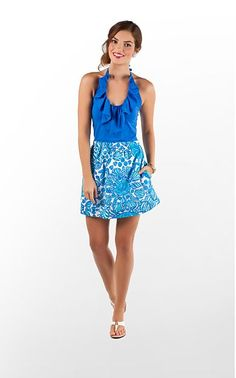 love this dress from the ruffles to the under the sea print on the skirt