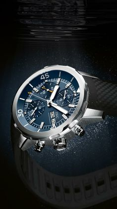 """Discover the IWC Aquatimer Chronograph edition """"Expedition Jacques-Yves Cousteau"""". The sea-blue dial and the small coral-red seconds hand acknowledge Cousteau's passion for coral reefs. Iwc Watches, Watches For Men, International Watch Company, Jacques Yves Cousteau, Watch Wallpaper, Iphone Wallpaper, Luxury Watches, Chronograph, Bracelet Watch"""