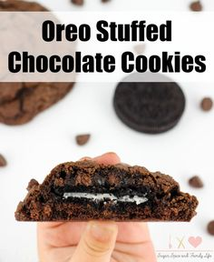 Oreo Stuffed Chocolate Chocolate Chip Cookies are the ultimate chocolate cookie dessert. They combine two popular cookies into one delicious cookie. Oreo cookie lovers and chocolate lovers will adore these big chocolatey cookies. - Oreo Stuffed Chocolate Cookies Recipe on Sugar, Spice and Family Life