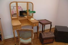 """Furniture from second floor room incl bird eye maple desk, 20""""x36""""x57"""" and chair, bookshelf, carved wood small trunk, antique scalloped edge and leather top side table and mid century style, black geometric block cabinet 20""""x20,"""" and a carved wood box."""