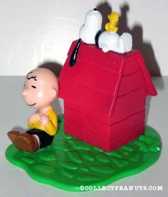 Snoopy and Woodstock on and  Charlie Brown sitting next to  doghouse  Cake Topper