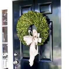 One of the easiest ways to transition into fall is to add a seasonal wreath to your front door. Burlap is a fall favorite. Make a bow out of burlap ribbon, and attach it to the bottom of the wreath with floral wire. Click through for more creative Fall decorating ideas.