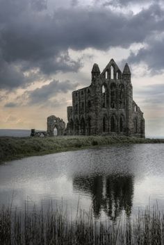 Whitby Abbey is a ruined Benedictine abbey overlooking the North Sea on the East Cliff above Whitby in North Yorkshire, England. Yet another ruin because of Henry VIII. Abandoned Churches, Abandoned Mansions, Abandoned Places In The Uk, Photo Post Mortem, Beautiful Buildings, Beautiful Places, Amazing Places, Whitby Abbey, Old Buildings