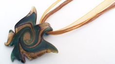 Green And Gold Butterfly Lamp Work Necklace With A Rich Dark Brown Flat And Round Ribbon Chain. An Ideal Gift