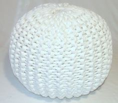 Knitted Pouf -- pattern. Easy! It's a long knit that then is just gathered together at the top and bottom.