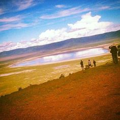Taking photos on the rim of the #NgorongoroCrater, #Tanzania. #CradleOfHumanity #Ngorongoro #NorthernCircuit #Nature #ChickAboutTownDotCom #Safari #NgorongoroConservationArea