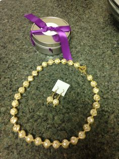 Bid on this beautiful gold necklace and matching earrings from Elm By Design jewelry makers.