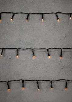 Illuminate your living space with the warm glow of these 50 LED string lights contained on a traditional green wire. Indoor use only. Warm white lights. 6 hour timer. Requires 2x AA batteries (not included).
