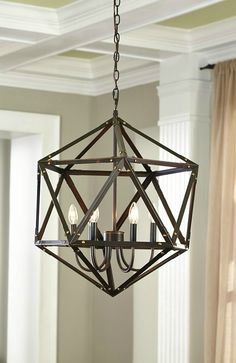 With its open, airy design, this stunning pendant light incorporates an indoor-outdoor look into your space, making it perfect for your entryway. Its rivet-style details offer rustic charm to your home that your guests are sure to notice.