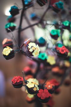 Rainbow blossom cupcake tree from a rather cool rainbow themed wedding. Follow the link for many, many photos.