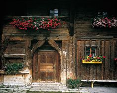 St. Anton am Arlberg, Tirol, Österreich: Brauchtum im Sommer - This old house is ca. 1000 years old, and served as 'Herberge' or last stop Gasthaus i.e. Inn for travelers over the Arlberg Pass. It was the road between Innsbruck or München to Zürich. Mostly bringing salt from the Salzbergwerke in Hall near Innsbruck. Across the street are still the renovated ' water troughs for the horses, which were used also as the last stop on the Mail Carrier or Post-Kutsche route.