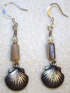 Handcrafted by Teal Palmetto, LLC. These earrings, with antique-silver-finished clam shell charms and taupe shell, were purchased by a customer in Beaufort, South Carolina.