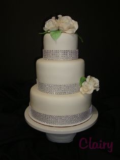 Simply Elegant! - A simple white wedding cake for Ana and Eric... with bling!  =)