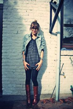Jean jacket, long plaid shirt, brown boots, and tights