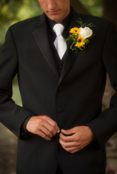 The groom. Sunflower flowers. Black with white tie.