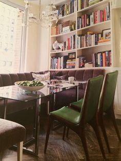 CB2 dining table, banquette upholstered in Maharam mohair, green upholstered wood chairs, built ins in dining room, designer Royce Pinkwater  House Beautiful, October 2011