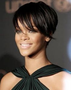 Amazing pixie with long bangs ... One of my very favorite cuts to do! I have round faced short hair envy!