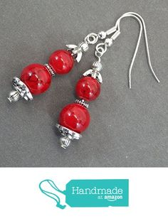 "Thurcolas earrings in reconstituted red turquoise beads and cups in antique silver Gorgeous earrings handmade in France with red turquoise beads reconstituted, tibetan beads and magnificent cups in antique silver. The set is mounted on ""French"" hooks in antique silver. Style: Boho, Classic Chic"