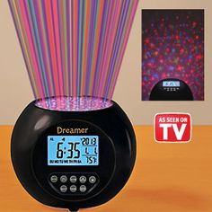 Dreamer Clock - Lets you drift off to sleep with a delightful show of multi-coloured lights...then rise and shine to the pleasing sounds of wind, water and nature. (Product Number HC6555) $27.98 CAD