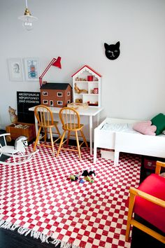 Bloesem kids: We love this red and white themed kids room... and don't you think the checked rug makes such a bold statement to the room