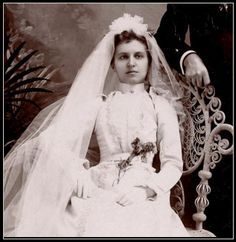 The Dead Bride. It's been supposed she's dead, looking at her hands, eyes and the dead flowers in her hands.