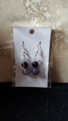 Clear and black earrings