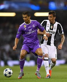 Cristiano Ronaldo of Real Madrid and Mario Mandzukic of Juventus battle for possession during the UEFA Champions League Final between Juventus and Real Madrid at National Stadium of Wales on June 3, 2017 in Cardiff, Wales.
