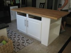 Add shelving to the end of our kitchen island, and replace with butcher block countertops. love this tutorial.