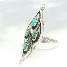 Vintage Sterling Southwestern Turquoise Ring Beautiful Marquise shape handmade sterling silver ring. Size 7-7.5, Native American old pawn. Tiny beautiful Turquoise gemstones and great style and craftsmanship. Circa 1970s. In great condition, no marks. Vintage  Jewelry Rings